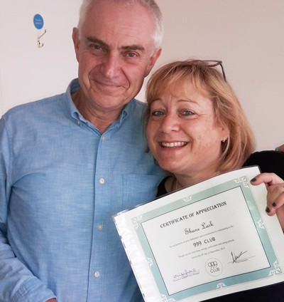 Shane getting a certificate of appreciate from Peter Wood